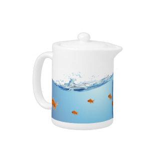 Goldfish under water aquarium teapot