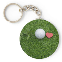 Golf baby with love and ball on green grass keychain