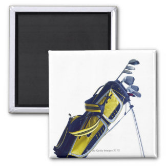 Golf bag with clubs on white background magnet