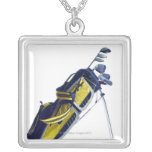 Golf bag with clubs on white background square pendant necklace