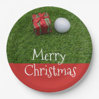 Golf ball and Christmas Present on green grass Paper Plate