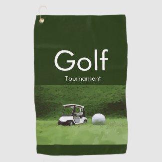 Golf ball and golf cart on green grass golf towel