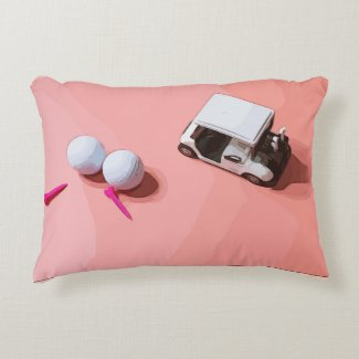 Golf ball and golf cart on pink pastel accent pillow