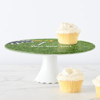 Golf ball and multi colour tees are on green grass cake stand
