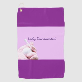 Golf ball and pink glove for lady tournament golf towel