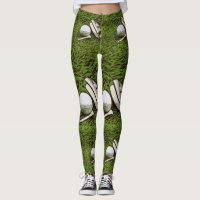 Golf ball and putter is on green grass leggings