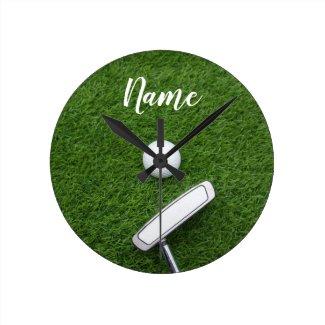 Golf ball and putter on green grass round clock