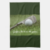 Golf ball and sand wedge golfers do it on green kitchen towel