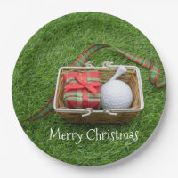 Golf ball and tee and Christmas ribbon on green Paper Plate