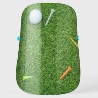 Golf ball and tee are on green grass face shield