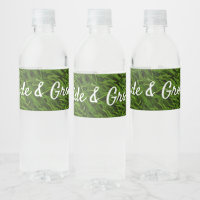 Golf ball and tee on green grass with love wedding water bottle label