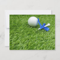 Golf ball and tee with blue polka dot ribbon