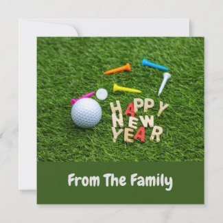 Golf ball and tee with Happy New Year on green