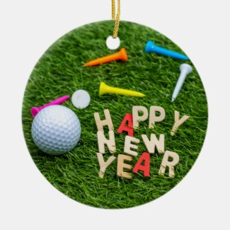Golf ball and tee with Happy New Year on green Ceramic Ornament