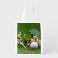 Golf ball and tee with love flower on green grocery bag