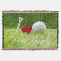 Golf ball and tee with love on green grass throw