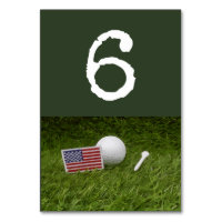 Golf ball and tee with U.S.A. flag on green Table Number