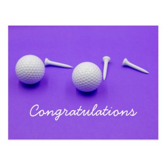 Golf ball and white tee are on purple background postcard