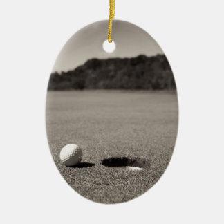 Golf Ball by Hole Ceramic Ornament