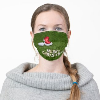 Golf ball Christmas with Santa Claus hat on green Cloth Face Mask
