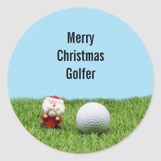 Golf ball Christmas with Santa Claus on green Classic Round Sticker