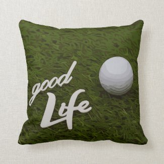Golf ball good life are on green grass throw pillow