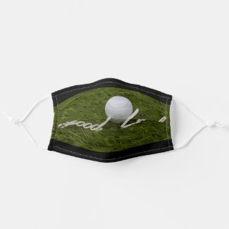 Golf ball goof luck hand writing on green grass cloth face mask