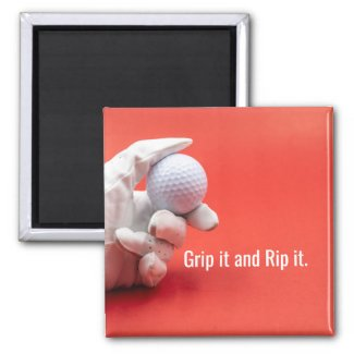 Golf ball in golfer hand on red background grip it magnet