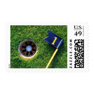 golf ball in hole postage stamp