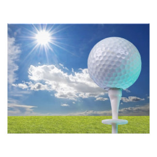 golf ball on a tee with grass flyer
