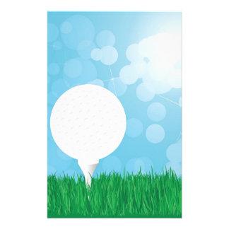 golf ball on grass stationery design