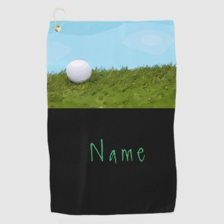 Golf ball on green gras with blue sky background golf towel