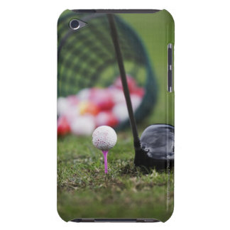 Golf ball on tee beside golf club iPod touch cover
