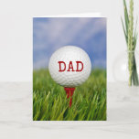 """golf ball on tee for Dad's birthday Card<br><div class=""""desc"""">close up of golf ball on red tee in green grass for Dad's birthday</div>"""