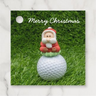 Golf ball Santa Claus is on green grass Christmas Favor Tags