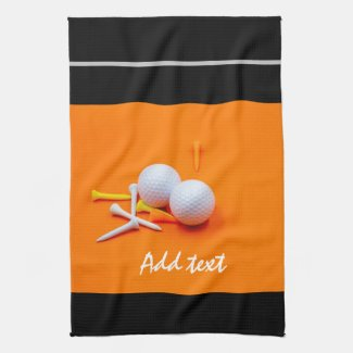 Golf ball white and yellow tees are on orange kitchen towel