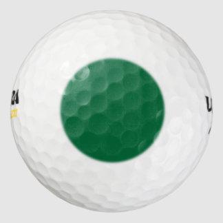 Golf Ball with a green dot hot spot locator guide