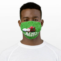Golf ball with Christmas gift on green grass Adult Cloth Face Mask