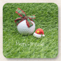 Golf ball with Christmas hat on green grass Beverage Coaster