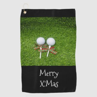 Golf ball with Christmas Holiday ribbon on green Golf Towel