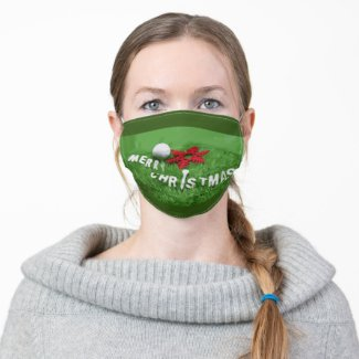 Golf ball with Christmas Ornament on green grass Cloth Face Mask