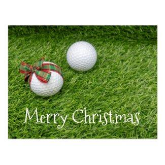 Golf ball with Christmas ribbon on Christmas Postcard