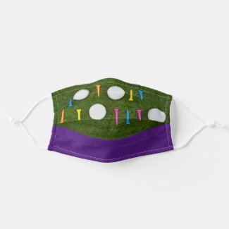 Golf ball with colorful tee on green birthday cloth face mask