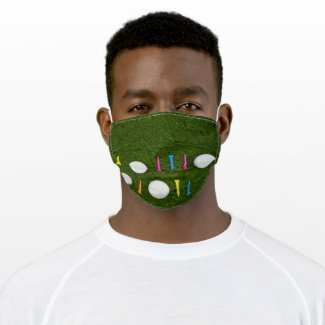Golf ball with colorful tee on green grass cloth face mask