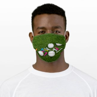 Golf ball with colorful tees are on green grass cloth face mask