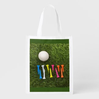 Golf ball with colourful tees are on green grocery bag
