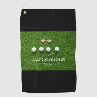 Golf ball with flag of America on green grass Golf Towel