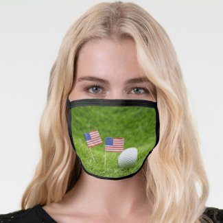 Golf ball with flag of America USA on green grass Face Mask