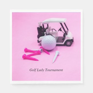 Golf ball with golf cart and pink  tee on pink napkin