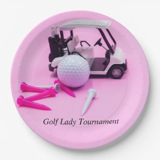 Golf ball with golf cart and pink tee on pink paper plate